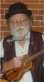 Jim with harp rack & uke.jpg